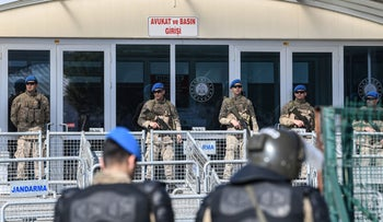 Turkish soldiers stand guard in front of the Silivri Prison and Courthouse complex in Silivri, near Istanbul, during the trial of Osman Kavala, along with 15 other people, February 18, 2020