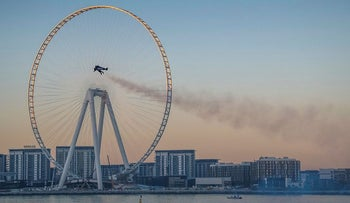 A handout picture released by the Expo 2020 on February 17, 2020, shows Vince Reffet, known as Jetman, taking part in a flight in the Emirati city of Dubai.