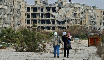 Residents of a neighborhood on the edge of the northern Syrian city of Aleppo return to their homes on February 18, 2020.