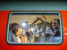 Former Transportation Minister Yisrael Katz (right) and current Transportation Minister Bezalel Smotrich inaugurate the Tel Aviv-Jerusalem train line, December 12, 2019.