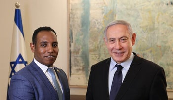 Netanyahu together with Gadi Yevarkan, an Ethiopian Israeli who was elected to the last Knesset as part of Kahol Lavan but recently jumped ship to Likud.