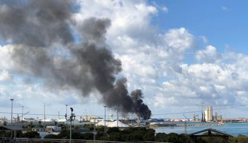 A smoke rises from a port of Tripoli after being attacked in Tripoli, Libya, February 18, 2020.