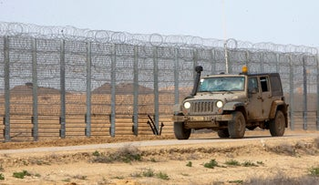 Israeli army vehicles driving along the Gaza border fence, February 2020.