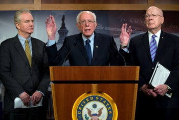 Sen. Bernie Sanders, I-Vt., accompanied by Sen. Chris Van Hollen, D-Md., and Sen. Patrick Leahy, D-Vt., speaks during a news conference on a measure limiting President Donald Trump's ability to take military action against Iran, on Capitol Hill, Washington, January 9, 2020.