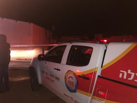 An emergency vehicle outside the site of the fire at Segev Shalom.