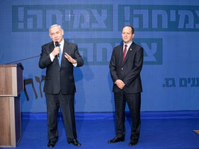 Prime Minister Benjamin Netanyahu and Likud's Nir Barkat speaking in Tel Aviv, February 2020.