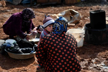 Syrian internally-displaced persons in a camp in Sarmada in the north of Syria's northwestern Idlib province on February 17, 2020