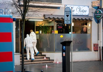 Forensic police work at a crime scene in front of a bar at the Heumarkt in the centre of Hanau, near Frankfurt am Main, western Germany, February 20, 2020