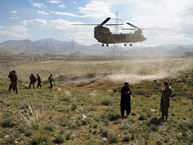 A U.S. military Chinook helicopter lands on a field in Maidan Shar, capital of Wardak province in Afghanistan on February 13, 2020.
