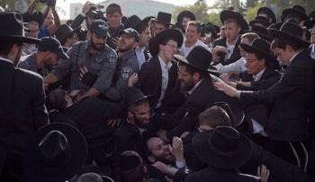 Israeli police scuffle with ultra-Orthodox Jews as they block a main road during a protest against Israeli army conscription, in Jerusalem, on October 19, 2017.