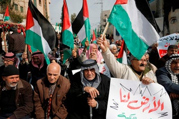 Palestinian refugees attend a protest against a U.S.-brokered peace proposal, next the UN building in Gaza City, February 20, 2020.