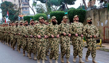 Fighters from the Lebanese Resistance Brigades, a paramilitary group affiliated with Hezbollah, march through Beirut's southern suburbs, February 14, 2020.