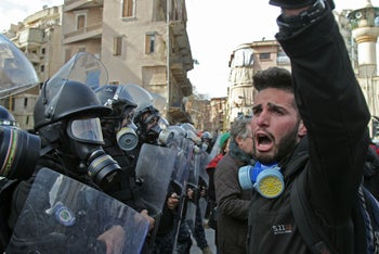 Lebanese protesters chant slogans during clashes with the security forces in Beirut, February 11, 2020.