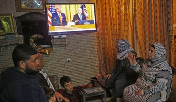 Palestinians watch the televised announcement of the Trump peace plan in Khan Yunis, Gaza, January 28, 2020.