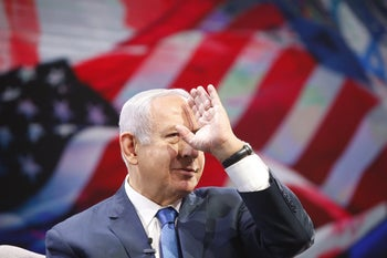 Prime Minister Benjamin Netanyahu waving at the General Assembly of the Jewish Federations of North America, Tel Aviv, October 24, 2018.