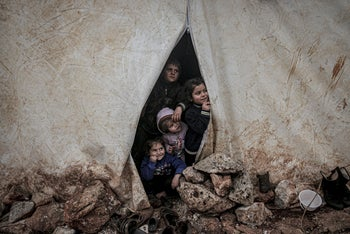 Internally displaced girls pose for a picture at a makeshift camp in Azaz, Syria, February 19, 2020.