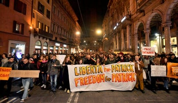 People hold a banner reading Freedom for Patrick as they stage a protest in Bologna, Italy, February 17, 2020.