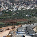 the Palestinian village of Turmus Ayya (background) and houses under construction in the Jewish settlement of Shilo in the occupied West Bank, March 2017.