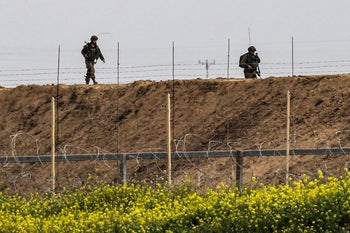 Israeli soldiers inspect the area around an observation post across the border fence with the southern Gaza Strip east of Khan Yunis on February 23, 2020.