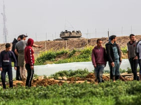 Palestinians demonstrate along along the Gaza-Israel border east of Khan Yunis in the southern Gaza Strip, February 23, 2020.