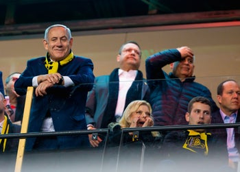 Benjamin Netanyahu and his family cheering for Betar Jerusalem in a soccer match against Hapoel Tel Aviv, February 17, 2020.