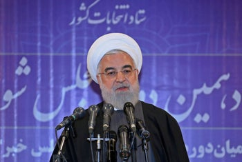 President Rohani speaking to the press after voting in Iran's parliamentary election.