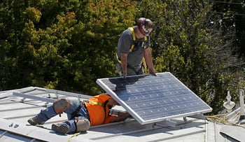 A solar panel is installed on a roof in Sacramento, California.