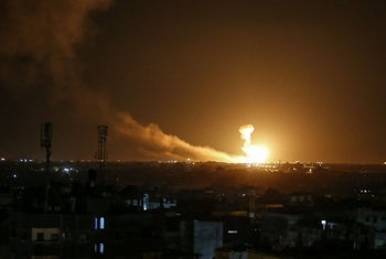 A ball of fire is seen following an Israel airstrike at Rafah in the southern Gaza Strip early on February 23, 2020