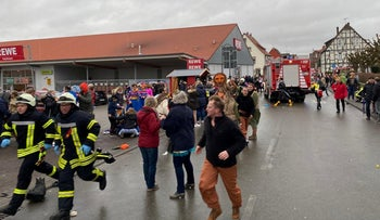 People react at the scene after a car ploughed into a carnival parade injuring several people in Volkmarsen, Germany, February 24, 2020.