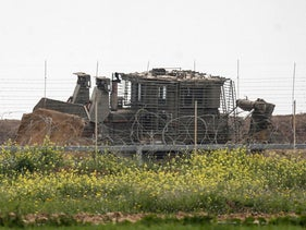 An Israeli earth mover along the Israel-Gaza border east of Khan Yunis in the southern Gaza Strip, February 23, 2020.