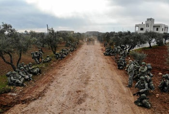 An aerial view shows Turkish soldiers gathering in the village of Qaminas, about 6 kilometers southeast of Idlib city in northwestern Syria, February 10, 2020