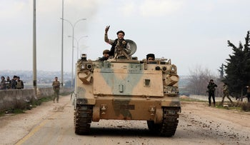 """Soldiers from the """"Syrian National Army"""", an alliance of Turkey-backed rebel groups, during a Turkey-backed military offensive on the village of Nayrab, February 24, 2020"""
