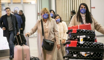 Travelers coming out of the arrivals hall at Ben Gurion international airport, Israel, February 25, 2020