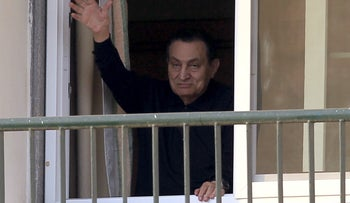 Ousted Egyptian president Hosni Mubarak waves to his supporters outside the area where he is hospitalized during his birthday at Maadi military hospital on the outskirts of Cairo, May 4, 2015.
