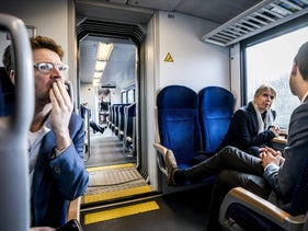People sit in a train car conducted by a Dutch public rail operator in Groningen, February 12, 2020.
