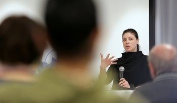 Labor-Gesher-Meretz candidate Merav Michaeli talking to Givat Brenner residents, February 22, 2020. Anyone wanting a government that won't be hostile to kibbutzim must vote for her party, she says.