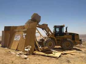 An Israeli bulldozer demolishes a makeshift structure near the West Bank city of Ramallah.