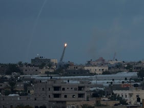 A rocket is fired towards Israel, in the southern Gaza Strip February 24, 2020.