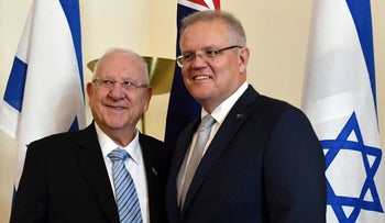 Israel's President Reuven Rivlin and Australia's Prime Minister Scott Morrison pose for photos at the Parliament House in Canberra on February 26, 2020.