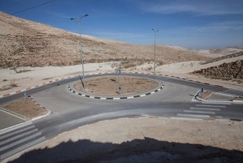 Roads, traffic circles, electricity poles, but no homes or residents, Area E-1, March 2012.
