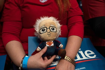A fan holding a stuffed doll replica of Democratic presidential hopeful Sen. Bernie Sanders as she awaits his arrival for a rally in El Paso, Texas, February 22, 2020.