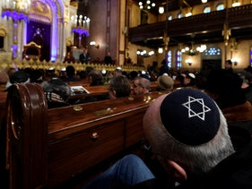 People attend a ceremony that commemorates the 75th anniversary of the liberation of the Budapest Jewish ghetto in Dohany Street Synagogue in Budapest, Hungary, January 19, 2020