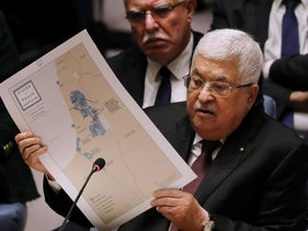 Palestinian President Mahmoud Abbas holds up a Vision for Peace map while speaking at the UN Security Council in New York, February 11, 2020.