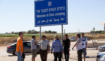 People stand at Gaza's Erez crossing, 2019.