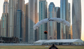 Dubai towers in the background as Vince Reffet, known as Jetman, conducts a flight, February 17, 2020.
