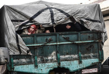 Civilians flee from Idlib toward the north to find safety inside Syria near the border with Turkey, February 15, 2020.