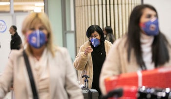 People wearing masks at the Ben-Gurion Airport to avoid contracting the coronavirus, February 25, 2020.