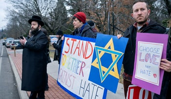 Neighbors gather to show their support of the community near a rabbi's residence in Monsey, N.Y., Sunday, December 29, 2019.