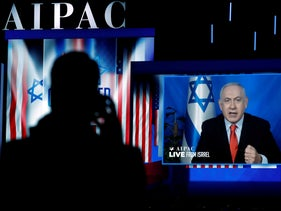 Speaking via satellite feed from Israel, Prime Minister Benjamin Netanyahu addresses the AIPAC  policy conference in Washington, March 26, 2019.