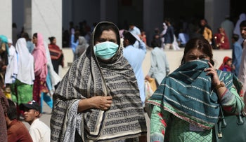 Pakistani women wearing face masks leave the Aga Khan hospital where a patient suspected of having contracted coronavirus was admitted, in Karachi, Pakistan, February 27, 2020.